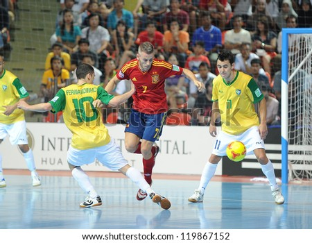 BANGKOK,THAILAND- NOV 18 : Miguelin(7)of Spain during action in FIFA Futsal World Cup thailand 2012 Between Spain (r) VS Brazil (y) on November 18, 2012 at Indoor Stadium Huamark in Bangkok Thailand. - stock photo
