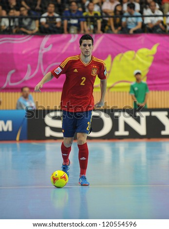 BANGKOK, THAILAND-NOV 14:Ortiz of Spain (r) run with the ball during the FIFA Futsal World Cup Quarterfinal Round between Spain and Russia at Nimibutr Stadium on Nov14,2012 in Bangkok, Thailand.