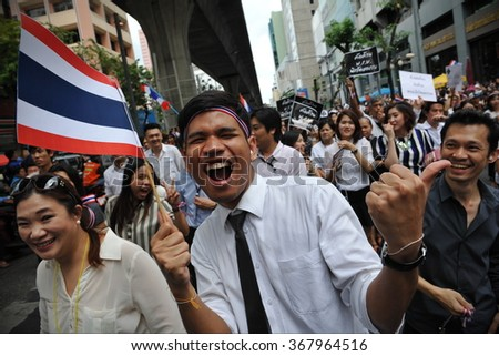 BANGKOK, THAILAND - NOV 6, 2013: Protesters chant slogans during a city centre anti government rally. The protesters oppose a contentious amnesty bill and call for the government to be overthrown. - stock photo