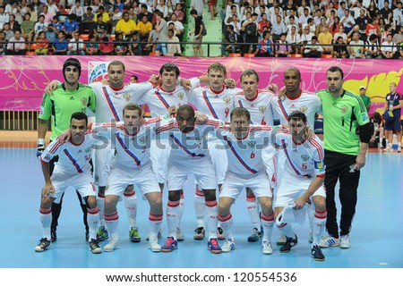 BANGKOK,THAILAND- NOV 14:Russia team post for a photo during the FIFA Futsal World CUP  between  Spain and Russia at Nimibutr stadium on Nov 14,2012 in Thailand. - stock photo