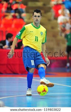BANGKOK, THAILAND - NOV 14: Simi in action during FIFA Futsal World Cup Quarter-Final match between Argentina (B) and Brazil (Y) at Indoor Stadium Huamark on November 14, 2012 in Bangkok, Thailand. - stock photo