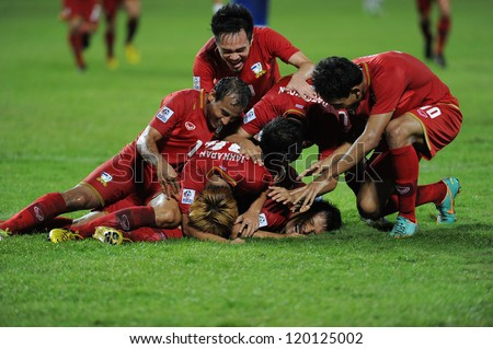 BANGKOK, THAILAND - NOV 24:Thailand player  celebrates after scoring during the AFF SUZUKI CUP 2012 between Thaialand and Philippines at Rajamangkala stadium on Nov 24,2012 in Thailand. - stock photo
