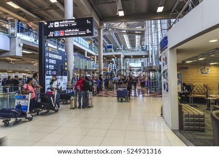 BANGKOK, THAILAND - NOV 04, 2016 - tourists walking pass the terminal of Suvarnabhumi International Airport at Bangkok, Thailand.