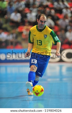 BANGKOK, THAILAND - NOV 14: Unidentified player in FIFA Futsal World Cup Quarter-Final match between Argentina (B) and Brazil (Y) at Indoor Stadium Huamark on November 14, 2012 in Bangkok, Thailand. - stock photo