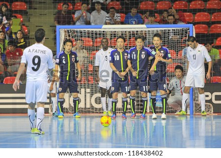 BANGKOK, THAILAND - NOV 7 : Unidentified players in FIFA Futsal World Cup Group C match between Japan (B) and Libya (W) at Indoor Stadium Huamark on November 7, 2012 in Bangkok, Thailand. - stock photo