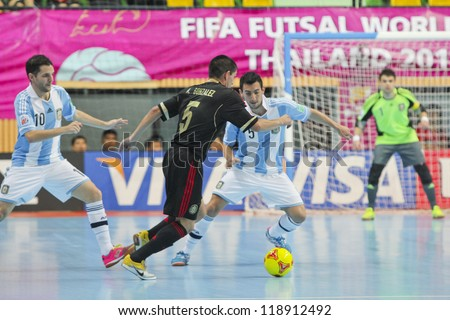 BANGKOK, THAILAND - NOV 2 : Unidentified players in FIFA Futsal World Cup thailand 2012 Between Argentina (Blue) VS Mexico (Black) on November 2, 2012 at Nimibutr Stadium in Bangkok Thailand. - stock photo
