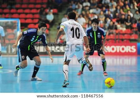 BANGKOK, THAILAND - NOV 7 : Unidentified players in the FIFA Futsal World Cup Group C match between Japan and Libya at Indoor Stadium Huamark on November 7, 2012 in Bangkok, Thailand. - stock photo