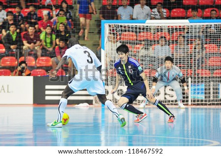 BANGKOK, THAILAND - NOV 7 : Unidentified players in the FIFA Futsal World Cup Group C match between Japan and Libya at Indoor Stadium Huamark on November 7, 2012 in Bangkok, Thailand.