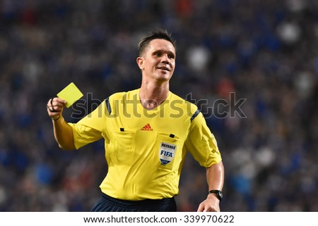 BANGKOK THAILAND NOV12 2015 :Unidentified referee show yellow card  during the Fifa World Cup Group F qualifying Match between Thailand and Chinese Taipei at Rajamangala Stadium in Thailand.