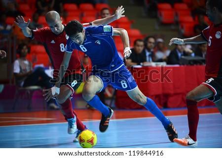 BANGKOK,THAILAND-NOVEMBER 09:Abdulrahman Alwadi of  Kuwait (blue) in action during the FIFA Futsal World Cup between Kuwait and Egypt at Indoor Stadium Huamark on Nov9,2012 in Bangkok,Thailand. - stock photo