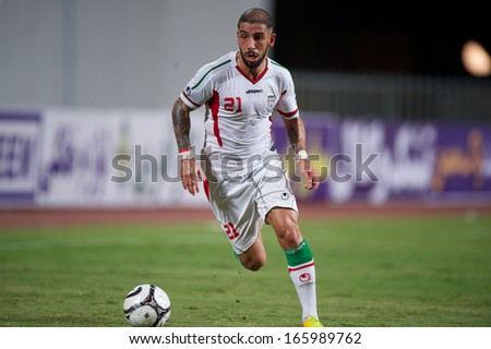 BANGKOK THAILAND-NOVEMBER 15:Ashkan Dejagah  of Iran run with the ball during the 2015 AFC Asian Cup qualifiers between Thailand and Iran at Rajamangala stadium on Nov15, 2013 in Thailand.