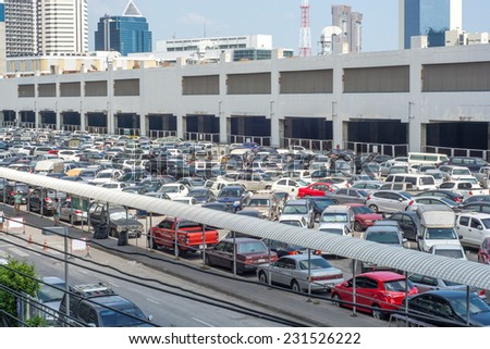 Bangkok,Thailand-November 16,2014:Cars parked at a park and side lot at a BTS station in Chatuchak district in Bangkok,Thailand.The government has promoted park and ride to reduce traffic congestion. - stock photo