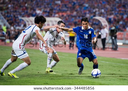 BANGKOK,THAILAND NOVEMBER 12:Chanathip Songkrasin (blue)of Thailand in action during the 2018 FIFA World Cup Qualifier Thailand and Chinese Taipei  at Rajamangala Stadium on Nov 12, 2015 in Thailand. - stock photo