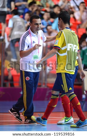 BANGKOK,THAILAND-NOVEMBER 18:Colombia coach Arney Fonnegra(L) in action during the FIFA Futsal World Cup 3rd/4th Playoff between Italy and Colombia at Indoor Stadium Huamark on Nov18,2012 in,Thailand.