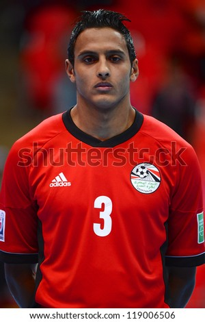 BANGKOK,THAILAND-NOVEMBER 06:Esiam Shalaby of Egypt looks on during the national anthem the FIFA Futsal World Cup between Egypt and Czech Republic at Indoor Stadium Huamark on Nov6,2012 in,Thailand. - stock photo