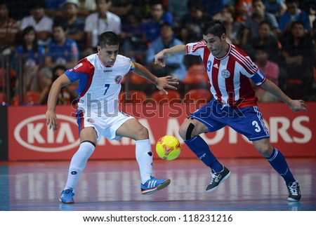 BANGKOK,THAILAND-NOVEMBER 04: Fabio Alcaraz of Paraguay for the ball during the FIFA Futsal World Cup between Paraguay and Costa Rica at Indoor Stadium Huamark on Nov4, 2012 in Bangkok, Thailand.