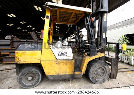 BANGKOK-THAILAND-NOVEMBER 4 : Forklift in warehouse on the way on November 4,2014, Bangkok Thailand.