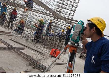 Bangkok, Thailand - November 10 2008 :  In a construction site, women and men work on metal structure. Salaries are very low. Most workers come from the north east of Thailand, Cambodia and Myanmar.