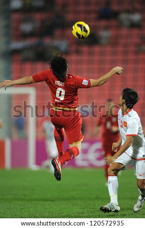 BANGKOK THAILAND-NOVEMBER 30:Kirati Keawsombut of Thailand (red) in action during the AFF Suzuki Cup between Vietnam and Thailand at Rajamangala stadium on Nov30, 2012 in Bangkok,Thailand.