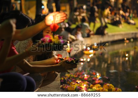 BANGKOK THAILAND - NOVEMBER 10 : Loy Krathong festival, Thai people buy flowers and candle to light and float on water to celebrate the Loy Krathong festival on November 10, 2011 in Bangkok, Thailand. - stock photo