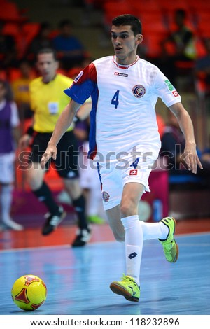 BANGKOK,THAILAND-NOVEMBER 04:Luis Navarrete of Costa Rica runs with the ball during the FIFA Futsal World Cup between Paraguay and Costa Rica at Indoor Stadium Huamark on Nov4,2012 in Thailand.