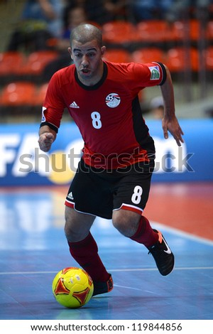 BANGKOK,THAILAND-NOVEMBER 09:Mizo of  Egypt (red) runs with the ball during the FIFA Futsal World Cup between Kuwait and Egypt at Indoor Stadium Huamark on Nov9,2012 in Bangkok,Thailand. - stock photo