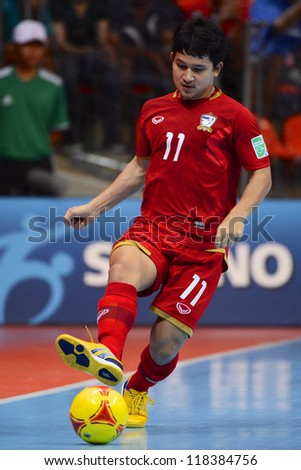 BANGKOK,THAILAND-NOVEMBER04:Nattavut Madyalan of Thailand in action during the FIFA Futsal World Cup between Thailand and Ukraine at Indoor Stadium Huamark on Nov4, 2012 in Bangkok, Thailand.