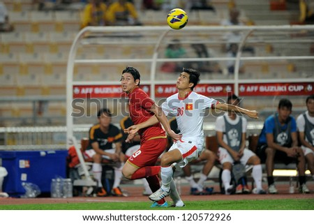 BANGKOK THAILAND-NOVEMBER 30:Nguyen Gia Tu of Vietnam ( white) in action during the AFF Suzuki Cup between Vietnam and Thailand at Rajamangala stadium on Nov30, 2012 in Bangkok,Thailand.