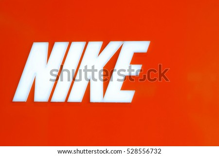 BANGKOK, THAILAND - NOVEMBER 26: Nike Logo on orange background on November 26, 2016. is an American corporation that was founded on January 25, 1964.