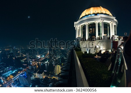 BANGKOK, THAILAND - NOVEMBER 18, 2015: Panoramic view over Bangkok skyline from the Scirocco Sky Bar over the Lebua Hotel at night time. - stock photo
