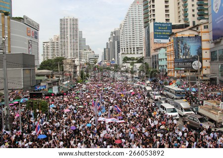 Bangkok, Thailand - November 7, 2013: Protestors hold an anti-government rally and gather together at Asok Intersection to blow whistles to make symbolic protest against the amnesty bill. - stock photo