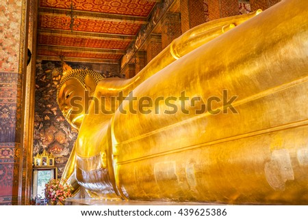 BANGKOK, THAILAND - NOVEMBER 09, 2014: Reclining Buddha figure in Wat Pho Buddhist temple complex in Bangkok, Thailand. - stock photo