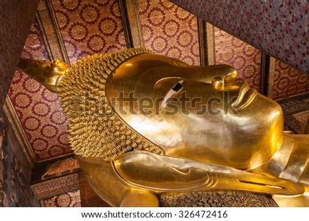 BANGKOK, THAILAND - NOVEMBER 09, 2014: Reclining Buddha head in Wat Pho Buddhist temple complex in Bangkok, Thailand. - stock photo