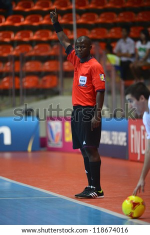 BANGKOK,THAILAND-NOVEMBER 06: Referee Jose Katemo (red) in action during the FIFA Futsal World Cup between Kuwait and Serbia at Indoor Stadium Huamark on Nov6, 2012 in Bangkok,Thailand.