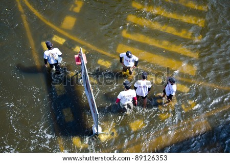 BANGKOK THAILAND – NOVEMBER 13: Scenes The Siam Commercial Bank, Limited  in Bangkok during its worst flooding in decades is a major disaster on November 13, 2011  in Bangkok, Thailand. - stock photo