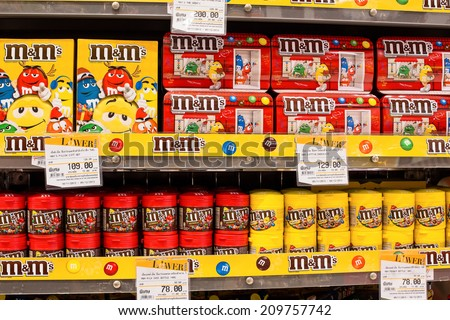 BANGKOK, THAILAND - NOVEMBER 19, 2013 : Selection chocolate candy M&M's on the shelves in a supermarket Siam Paragon. With 300,000 sq m of retail space Siam Paragon is one of the world's largest malls