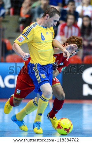 BANGKOK,THAILAND-NOVEMBER04: Sergiy Cheporniok  (yellow) of Ukraine  in action during the FIFA Futsal World Cup between Thailand and Ukraine at Indoor Stadium Huamark on Nov4, 2012 in,Thailand.