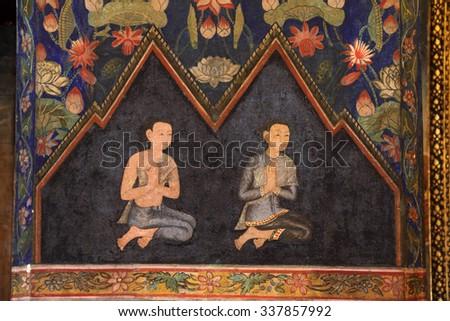 BANGKOK, THAILAND, NOVEMBER 3, 2015: Thai mural painting ,people are praying in the Wat pathum wanaram Buddhist temple in Bangkok, Thailand. - stock photo