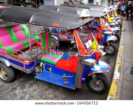 BANGKOK, THAILAND-NOVEMBER 16, 2013: Tuk-tuk (three-wheeler or auto rickshaw), is a widely used mode of transport in Bangkok and other cities in Thailand. November 16 2013