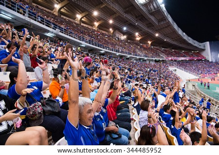 BANGKOK,THAILAND NOVEMBER 12:Unidentified fan of Thailand supporters during the 2018 FIFA World Cup Qualifier between Thailand and Chinese Taipei  at Rajamangala Stadium on Nov 12, 2015 in Thailand. - stock photo