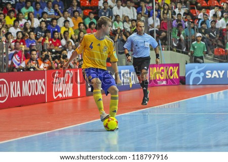 BANGKOK, THAILAND - NOVEMBER 04: Unidentified players in FIFA Futsal World Cup Group A match between Thailand and Ukraine at Indoor Stadium Huamark on November 4, 2012 in Bangkok, Thailand. - stock photo