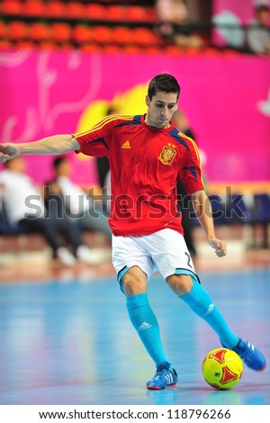 BANGKOK, THAILAND - NOVEMBER 11: Unidentified players in FIFA Futsal World Cup, Round of 16 match between Thailand (R) and Spain (B) at Nimibutr Stadium on November 11, 2012 in Bangkok, Thailand. - stock photo
