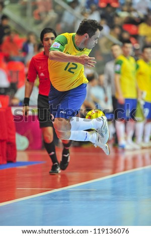 BANGKOK, THAILAND - NOVEMBER 16: Unidentified players in FIFA Futsal World Cup Semi-Final match between Brazil and Colombia at Indoor Stadium Huamark on November 16, 2012 in Bangkok, Thailand. - stock photo