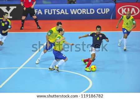 BANGKOK, THAILAND - NOVEMBER 16 : Unidentified players in FIFA Futsal World Cup, Semi-Final match between Brazil and Colombia at Indoor Stadium Huamark on November 16, 2012 in Bangkok, Thailand. - stock photo