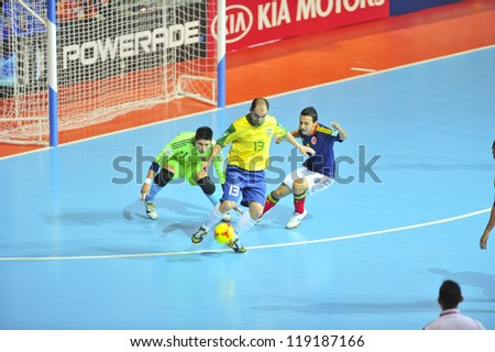 BANGKOK, THAILAND - NOVEMBER 16:Unidentified players in FIFA Futsal World Cup, Semi-Final match between Brazil and Colombia at Indoor Stadium Huamark on November 16, 2012 in Bangkok, Thailand.