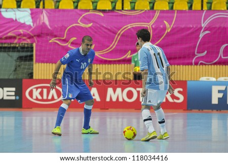 BANGKOK, THAILAND - NOVEMBER 05 :Unidentified players in FIFA Futsal World Cup Thailand 2012, Group D match between Argentina and Italy at Nimibutr Stadium on November 5, 2012 in Bangkok, Thailand - stock photo