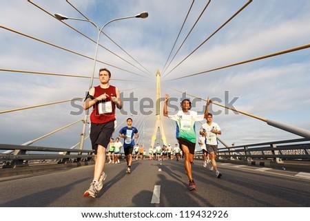 BANGKOK, THAILAND - NOVEMBER 18:  Unidentified runner at  Standard Charterd Bangkok Marathon 2012 running championship on November 18, 2012 in Bangkok, Thailand. - stock photo