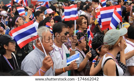 BANGKOK, THAILAND -NOVEMBER 24, 2013:Unidentified Thai protesters raise thai flag and blow whistles to anti amnesty bill. It claims that Up to million Thai people gather on such day.