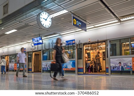 BANGKOK, THAILAND - NOVEMBER 13, 2015: Unidentified travellers walking inside MRT underground station. The MRT serves 240,000 passengers daily with 20 km of city centre track. - stock photo