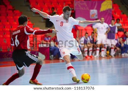 BANGKOK,THAILAND-NOVEMBER 03: Vladimir Lazic (white) of Serbia in action during the FIFA Futsal World Cup between Egypt and Serbia at Indoor Stadium Huamark on Nov3,2012 in Bangkok,Thailand. - stock photo